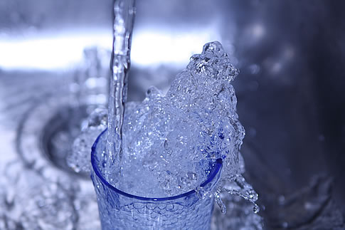 Overflowing Glass of Water