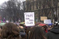 Placard at Anti-Burlusconi Protest in Milan - ask an Italian for a translation.