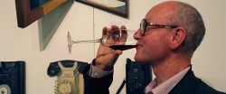 Artist Paul Critchely Enjoying a Drop of Wine