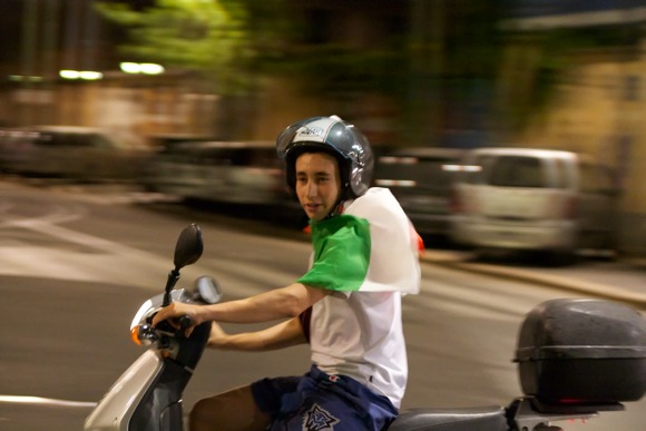 A Young Italian Scooter Rider Celebrating Italy's Win over Germany in Milan