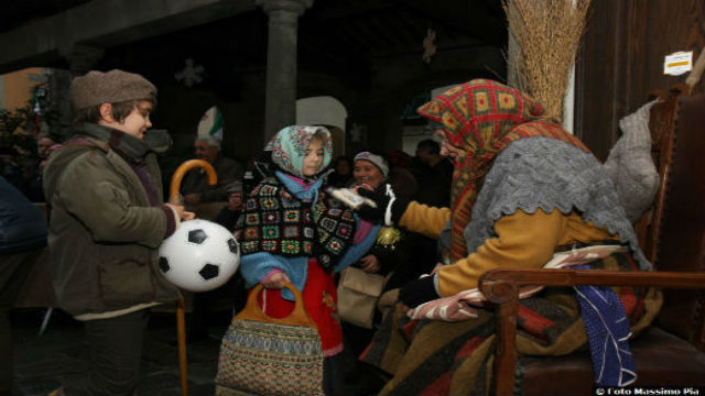 Befana meets the children. Photo Jenny Meas
