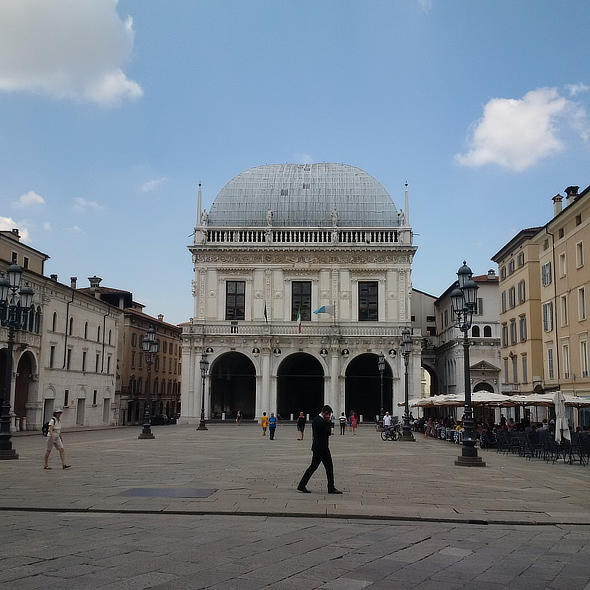 Visit Italy and see places like Brescia's Piazza Loggia Facade